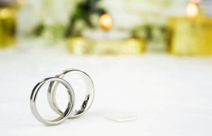 Bride and groom gold and white gold wedding rings. Image shot 2012. Exact date unknown.