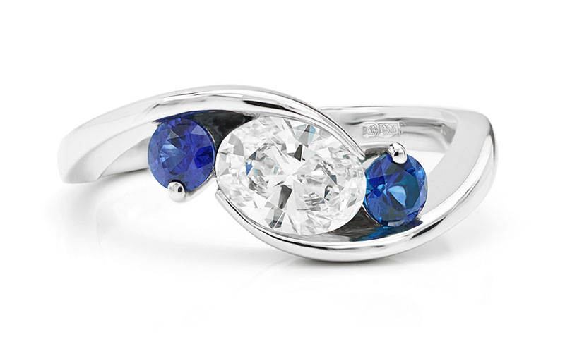 3 stone promise ring with blue sapphire and diamonds