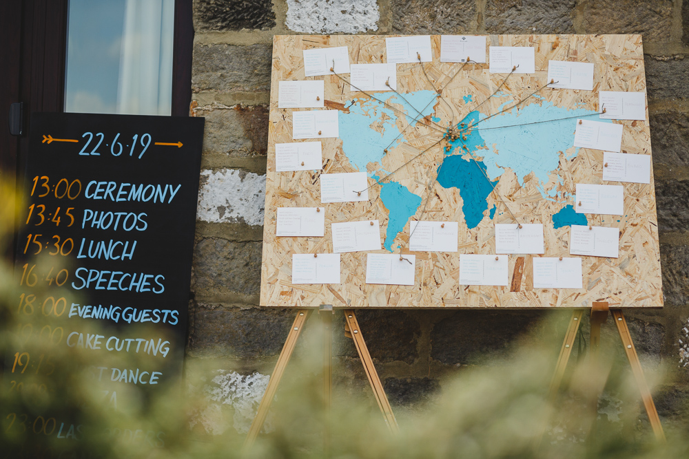World Map Table Plan Order of the Day East Keswick Village Hall Wedding James & Lianne Wedding Photography