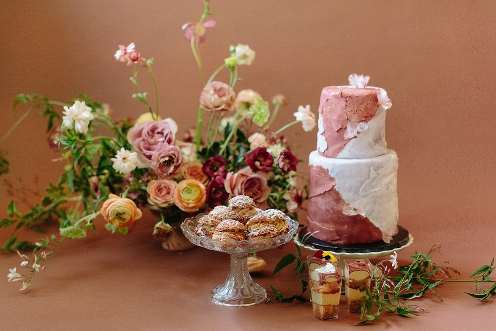 two tiered cake with sweet treats