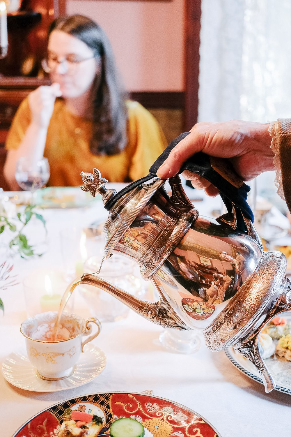close up photo of guest pouring tea