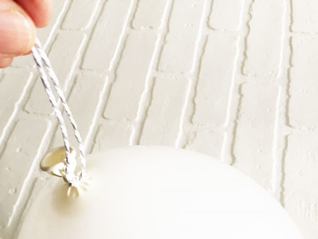 3 inches of twine tied around a white balloon
