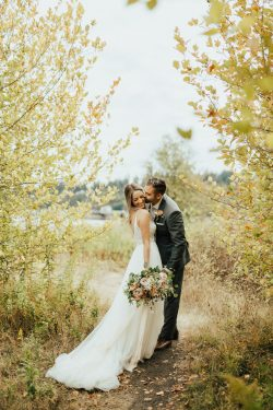 Groom Kissing Real Bride Wearing Boho A-line Wedding Dress Called Charlene by Maggie Sottero