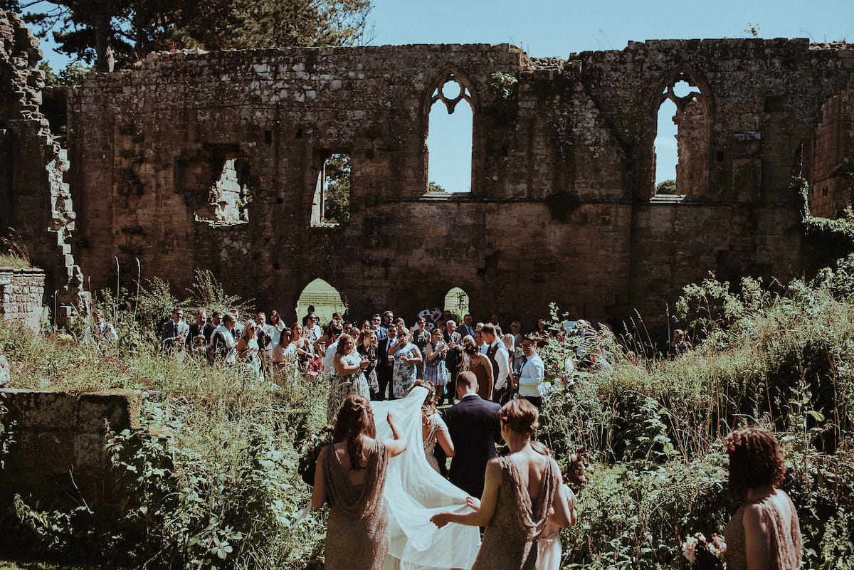 Our Favorite Boho Brides and Boho Wedding Dresses! - Maggie Bride wearing Ettia by Maggie Sottero. Boho brides will love the medieval ruins backdrop of this gorgeous wedding.