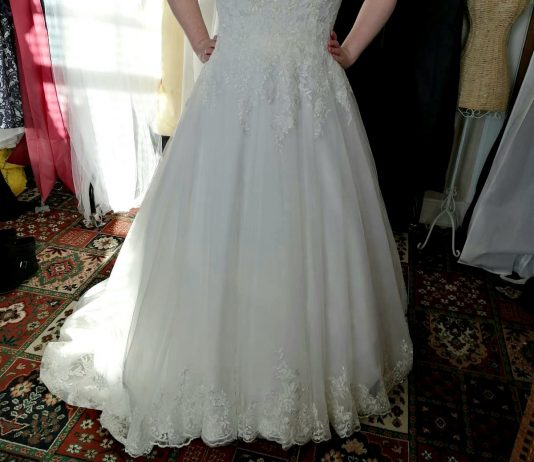 Picked my dress up from the seamstress today, not the best picture but I love it so much. 5 weeks on Monday!!