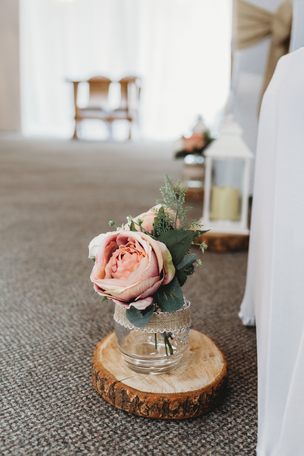 Aisle Flowers Pew End Pink Rose Jar Log Slice Crug Glas Country House Wedding Simon Murray Images