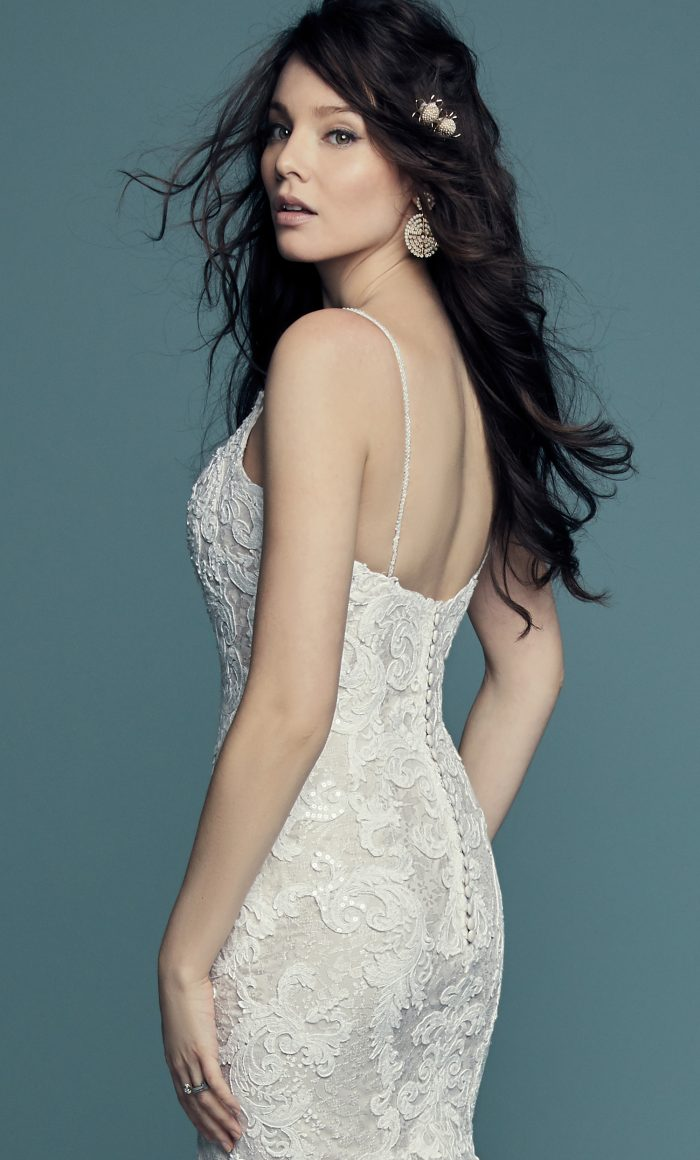 Model Wearing Lace Sheath Wedding Gown Called Tuscany by Maggie Sottero