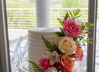 Textured iced and flowers wedding cake at Landtscap