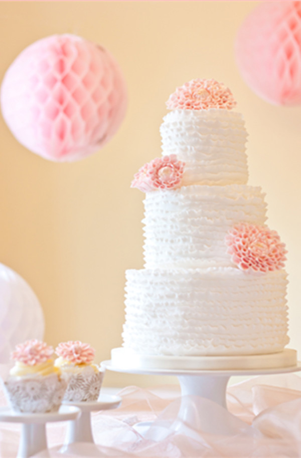 white and pink flower wedding cake