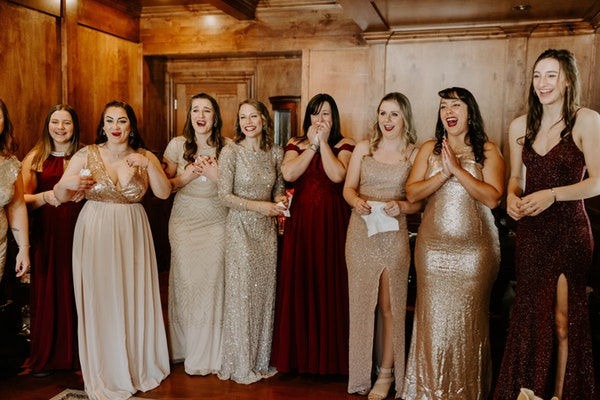 Green and Red and Gold Dresses and Bridesmaids
