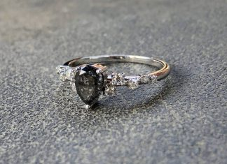 Had requests for the ring on a less fuzzy surface (blanket)! Here it is. Salt and pepper diamond center stone w/ moissanite offset side stones. So in love with this.