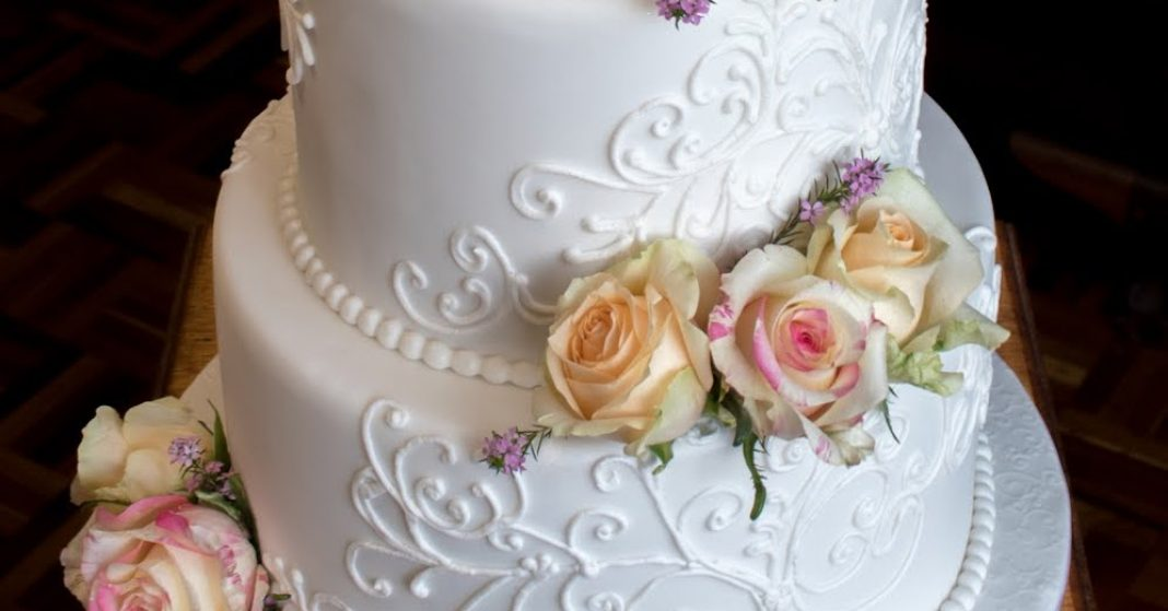 3 Tier Hand Piped cake with fresh flowers