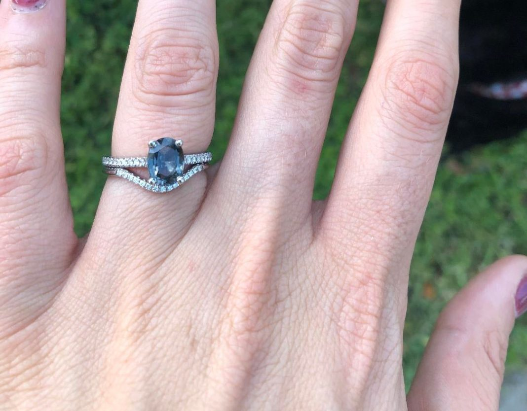 I am so in love with my blue grey spinel engagement ring. Sorry it's not in the center of my finger but I was walking my dog 😅 : EngagementRings