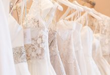 rack of wedding dresses hanging in Denver bridal shop