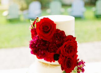 2 tier semi naked white wedding cake with fresh red garden roses