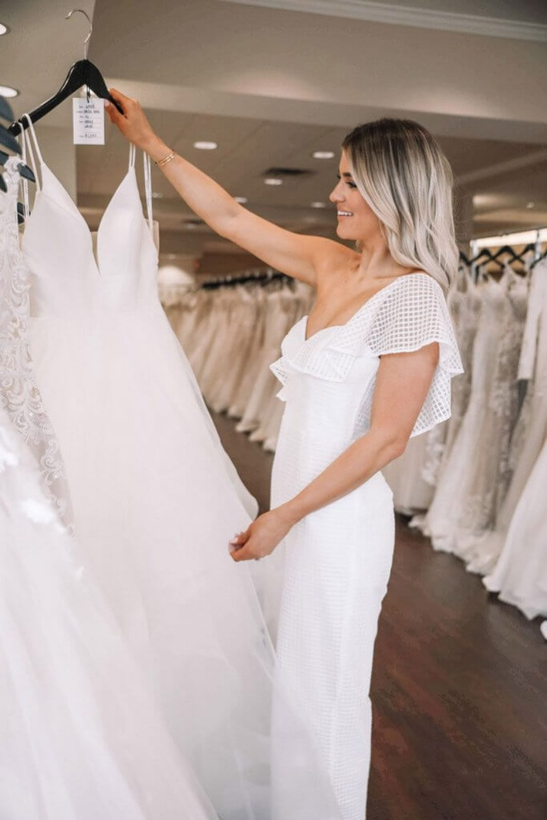 maid of honor browsing wedding gowns