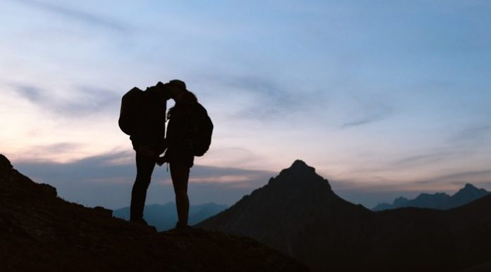 adventurous hiking couple after sunset