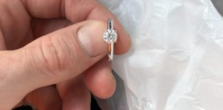 She likes plain and simple solo style. It is A 3/4 carat , 14k white gold. I don't want her to be embarrassed to wear it tho